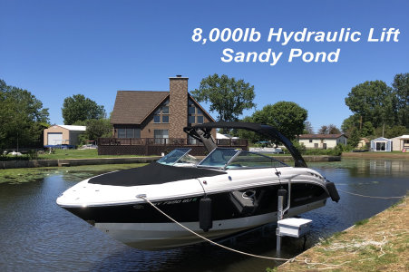 Picture of an 8000 pound hydraulic lift on Sandy Pond